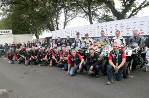 PACEMAKER, BELFAST, 29/8/2015: Brian Crighton and staff from the National Motorcycle Museum with the riders and rotary Nortons that took part in the Norton Rotary parade lap during the Classic TT. PICTURE BY STEPHEN DAVISON